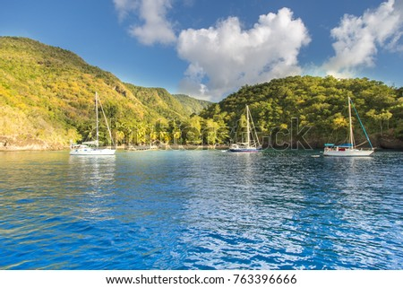 Sail boats anchored in the black bay (Anse noire) in Martinique island . This is just next to the