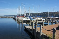 Sail boats at the boat marina at the southern end of Seneca lake in Watkins Glen New York on a beautiful blue sky day in autumn.
