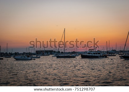 Sail boats docked with sea ocean background. Maritime boats docked with sunset colorful clouds.