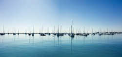Sail Boats on a beautiful cloudless day in the marina