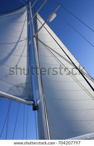 Sail on a yacht against blue sky. #704207797
