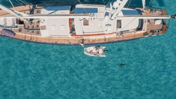 Sail Yacht and Shark Anchored