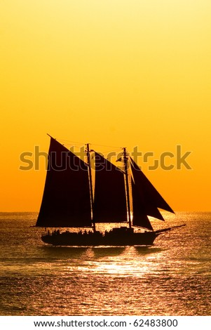 Sailboat against a beautiful sunset in Key West