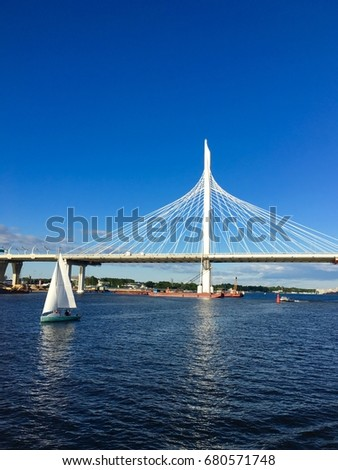 Sailboat against the white bridge #680571748