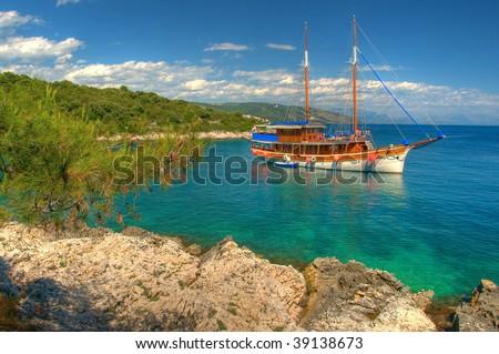Sailboat anchored at the beautiful bay in Croatia - stock photo