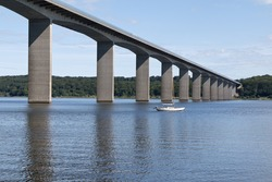 Sailboat at the bridge over the inlet at Vejle, Denmark