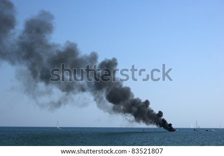 Sailboat burning in the sea