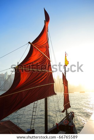 sailboat flag in Hong Kong harbor