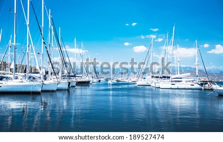 Sailboat harbor, many beautiful moored sail yachts in the sea port, modern water transport, summertime vacation, luxury lifestyle and wealth concept stock photo