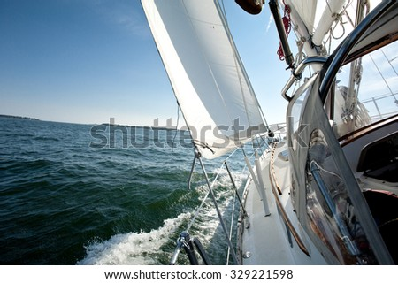 Sailboat heeling on a sunny day