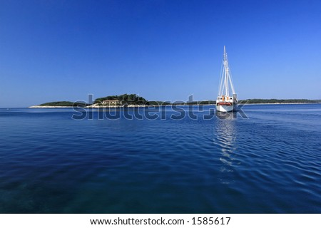 Sailboat in the bay - stock photo