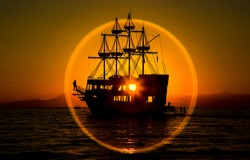 Sailboat in the center of the sunset. Sunset sailboat sailing. Sainling at sunset on sailboat