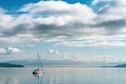 Sailboat in the morning sunlight docked in Penn Cove