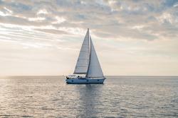 Sailboat in the sea in the sunset, luxury summer adventure, in Mediterranean sea, Europe