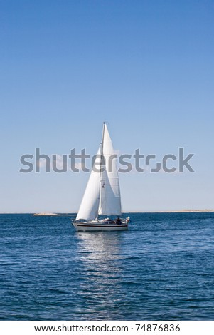 Sailboat in the sea one summer day
