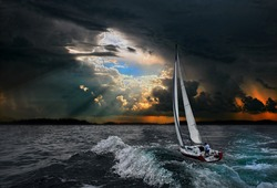 Sailboat in the storm sea.Yacht and beautiful seascape.Travel on a sailing boat.A hurricane in a stormy sea.