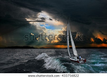 Sailboat in the storm sea.Yacht and beautiful seascape.Travel on a sailing boat.Leader.Abstract backgrounds. #433756822