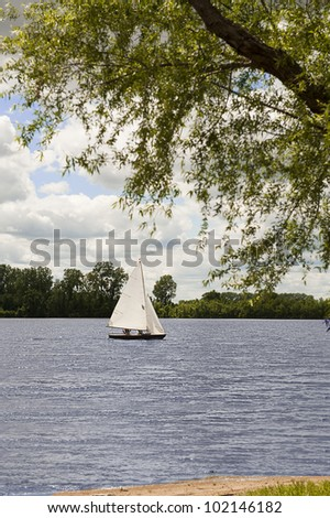 Sailboat makes its way across Creve Coeur Lake on a cloudy day