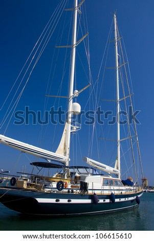 Sailboat moored in Mandraki harbor, Rhodes, Greece