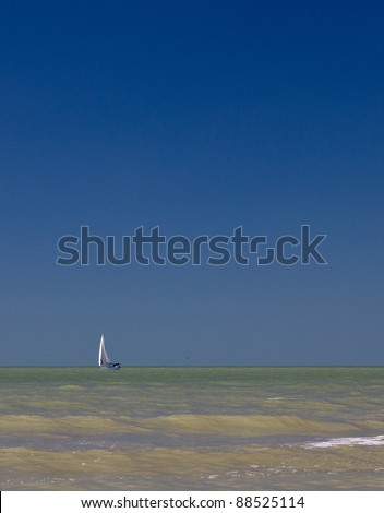 Sailboat on green water
