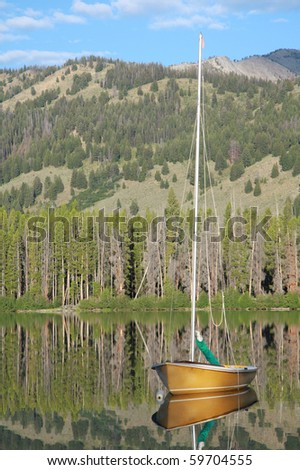 Sailboat on mountain lake