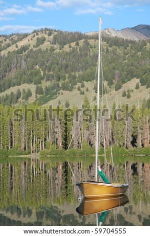 Sailboat on mountain lake