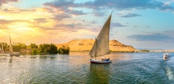 Sailboat on river Nile at sunset in Aswan, Egypt