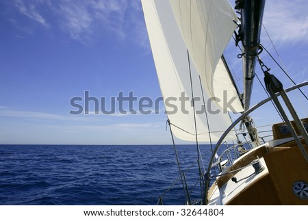 Sailboat sailing blue sea on sunny summer day in Mediterranean - stock photo
