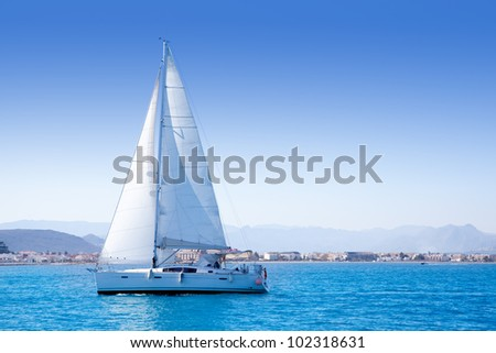 sailboat sailing in Mediterranean sea in Denia blue Mediterranean