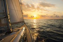 Sailboat sailing in the Mediterranean Sea at sunset