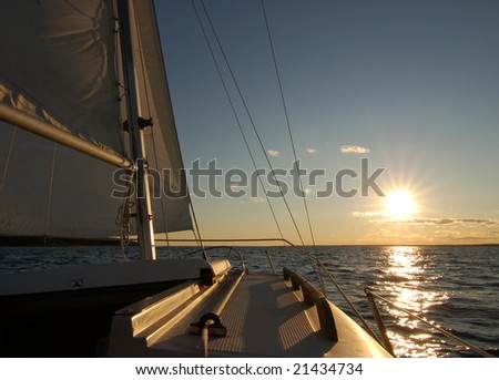 Sailboat sailing into the sun