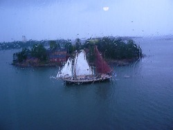 Sailboat through the window in rainy day
