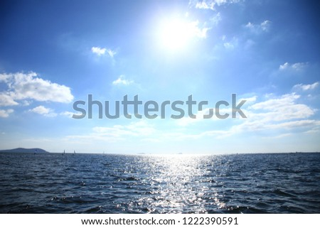 Sailboat travels with wind help, in calm sea. People enjoy the sailing, cloudy sky and mountains background, banner. #1222390591