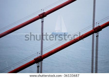 Sailboat under Golden Gate Bridge, San Francisco. - stock photo