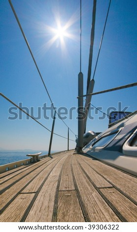 Sailboat with blue sky and sun