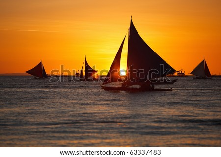 Sailboats against beautiful sunset in Boracay Philippines