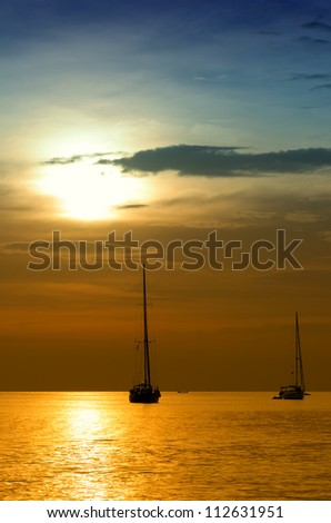 Sailboats at dusk. Tropical landscape.