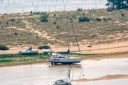 Sailboats at low tide in Bassin d'Arcachon - Cap Ferret, Aquitaine, France