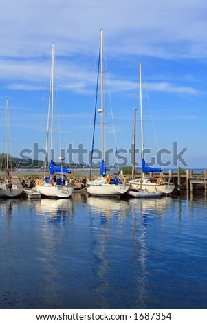 Sailboats at rest on a summer afternoon in Michigan