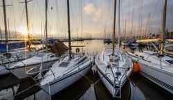 Sailboats dan sunrise at Versoix marina, Lake Geneva, Switzerland