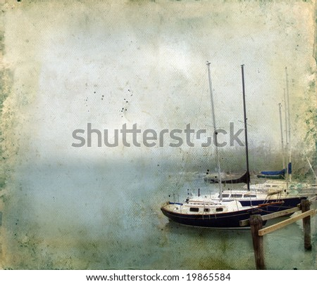 Sailboats docked in the fog on a grunge background. Copy-space for your text.