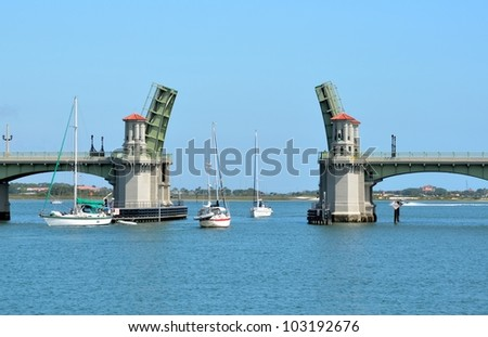 Sailboats going through The Bridge of Lions at historic St. Augustine, Florida, USA.