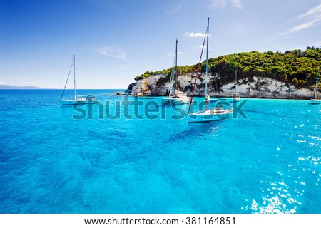 Sailboats in a beautiful bay, Paxos island, Greece #381164851