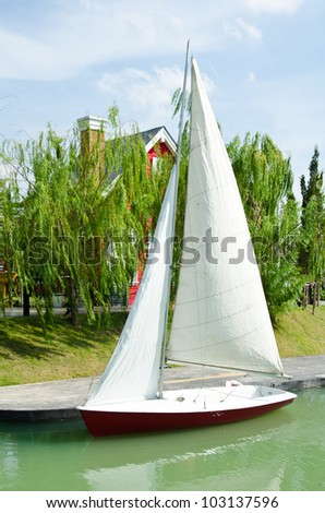 Sailboats in a quiet harbor on ocean - stock photo