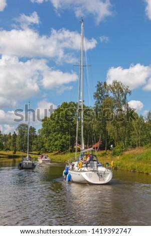 Sailboats on an idyllic canal #1419392747