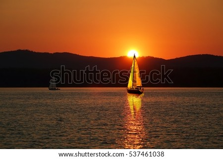 Sailboats on the beautiful Lake of the Southern Urals.Sailboat in the sunset.Summer travel.                               #537461038