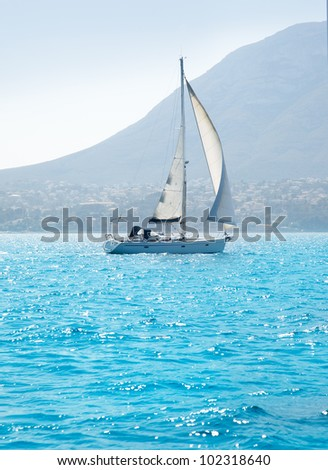 sailboats sailing in mediterranean sea on Denia Alicante