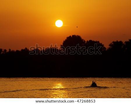 sailing at sunset on river Danube