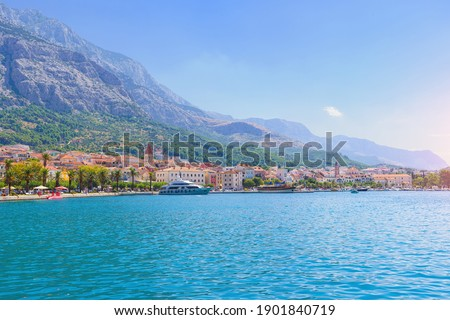 Sailing boat anchoring in Baška Voda town with historic buildin Stock fotó ©
