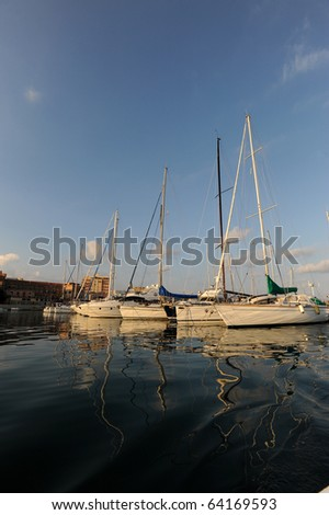 Sailing boat and reflection in Siracusa harbour